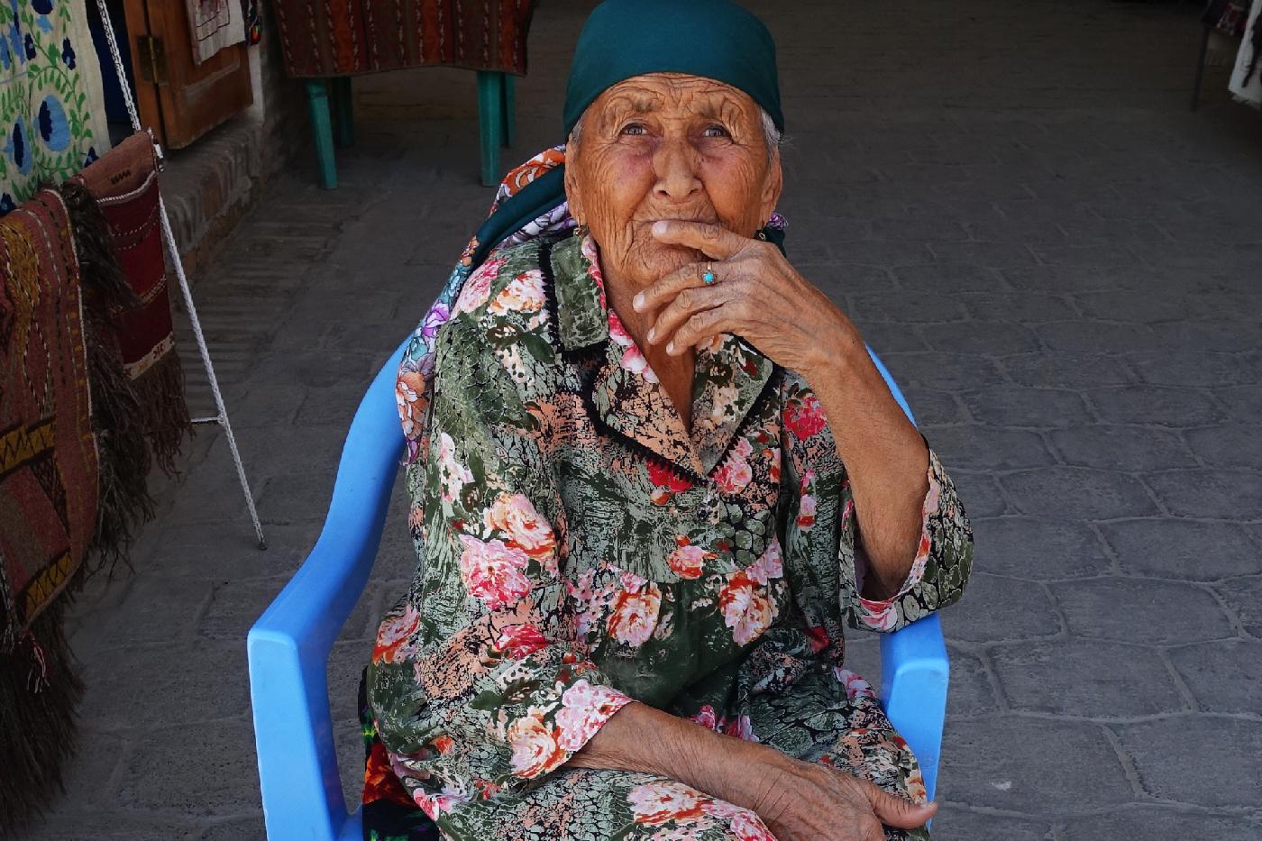 Boukhara old woman street vendor Uzbekistan